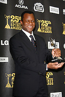 US actor Geoffrey Fletcher poses with his award in the press room at the 25th Independent Spirit Awards held at the Nokia Theater in Los Angeles on March 5, 2010. The Independent Spirit Awards is a celebration honoring films made by filmmakers who embody independence and originality...Photo by Nina Prommer/Milestone Photo