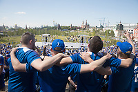 MOSCOW, RUSSIA - June 16, 2018: Iceland fans join arm-in-arm and sing a song during a pre-game rally at Zaryadiye park before their game against Argentina at the 2018 FIFA World Cup.
