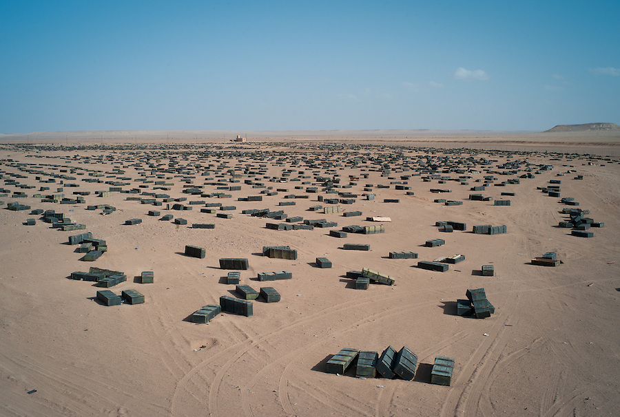Munitions crates strewn across the landscape next to unguarded weapons storage bunkers in the Sahara Desert, Libya, Wednesday, October 26, 2011. With the civil war over, one of Libya's biggest obstacles will be securing the huge stockpiles of weapons and preventing dangerous materials from falling into the wrong hands.