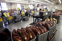 20 January 2005: Plastic tubs full of NFL footballs are lined up for final production at the Wilson football factory where Super Bowl footballs are made Thursday January 20, 2005 in Ada, Ohio.<br />