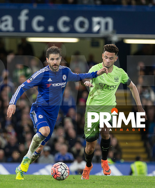 Cesc Fabregas of Chelsea holds off  David Faupala of Man City during the FA Cup 5th round match between Chelsea and Manchester City at Stamford Bridge, London, England on 21 February 2016. Photo by Andy Rowland.