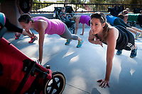 Briana Strawn, LEFT, Gilbert and Jessica Baronas, Mesa work out in their  Fit4Mom class at the Phoenix Zoo.