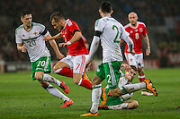 Paddy McNair of Northern Ireland tackles George Williams of Wales during the International Friendly match between Wales and Northern Ireland at Cardiff City Stadium, Cardiff, Wales on 24 March 2016. Photo by Mark  Hawkins / PRiME Media Images.