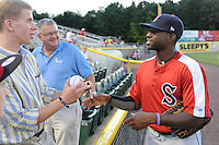 Outfielder Jackie Bradley Jr. (16) of the Salem Red Sox signs an autograph before a game against the Potomac Nationals on June 8, 2012, at Pfitzner Stadium in Woodbridge, Virginia. Potomac won the second game of a doubleheader, 4-2. Bradley is the No. 10 Boston prospect, according to Baseball America. (Tom Priddy/Four Seam Images)