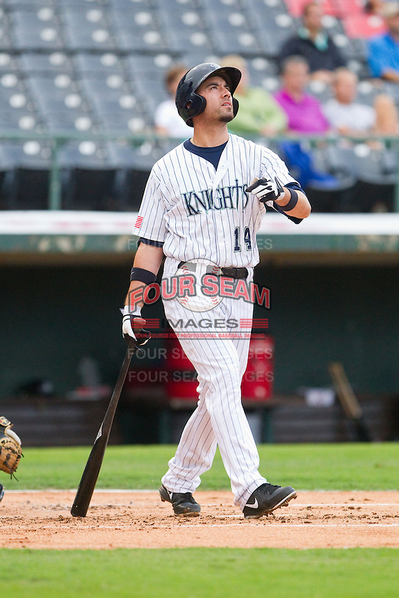 Travis Ishikawa (14) of the Charlotte Knights follows through on his swing against the Lehigh Valley IronPigs at Knights Stadium on August 6, 2013 in Fort Mill, South Carolina.  The IronPigs defeated the Knights 4-1.  (Brian Westerholt/Four Seam Images)