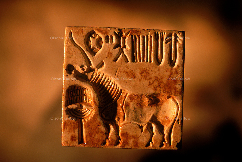 Harappan Unicorn Seal--2400-2000 BC.  This seal has important script showing two signs identical to early Indus script seen on sherds dating to 2800BC.   4,800 years ago, at the same time as the early civilizations of Mesopotamia and Egypt, great cities arose along the flood plains of the Indus and Saraswati (Ghaggar-Hakra) rivers.  Developments at Harappa have pushed the dates back 200 years for this civilization, proving once and for all, that this civilization was not just an offshoot of Mesopotamia..They were a highly organized and very successful civilization.  They built some of the world's first planned cities, created one of the world's first written languages and thrived in an area twice as large as Egypt or Mesopotamia for 900 years (1500 settlements spread over 280,000 square miles on the subcontinent)..There are three major communities--Harappa, Mohenjo Daro, and Dholavira. The town of Harappa flourished during this period because of it's location at the convergence of several trade routes that spanned a 1040 KM swath from the northern mountains to the coast.
