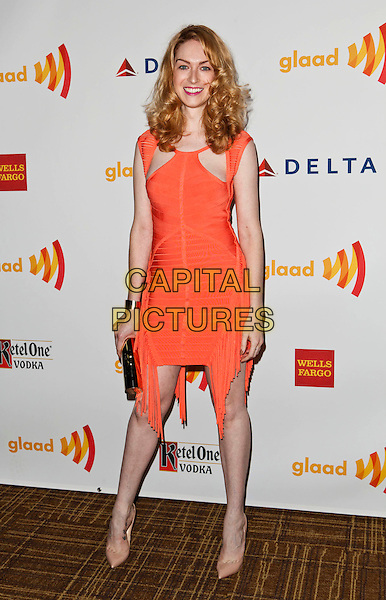 Jamie Clayton.23rd Annual GLAAD Media Awards - Arrivals held at Westin Bonaventure Hotel, Los Angeles, California, USA..April 21st, 2012.full length orange dress fringed .CAP/ADM/ES.©Emiley Schweich/AdMedia/Capital Pictures.