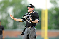 Home plate umpire Rich Grassa smiles during a game between the Augusta GreenJackets and the Greenville Drive on Thursday, July 10, 2014, at Fluor Field at the West End in Greenville, South Carolina. (Tom Priddy/Four Seam Images)