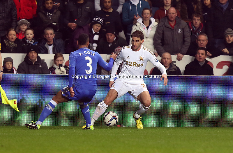 Wednesday 23 January 2013<br /> Pictured: Angel rangel of Swansea (R) against Ashley Cole of Chelsea<br /> Re: Capital One Cup semi-final second leg, Swansea City FC v Chelsea at the Liberty Stadium, south Wales.
