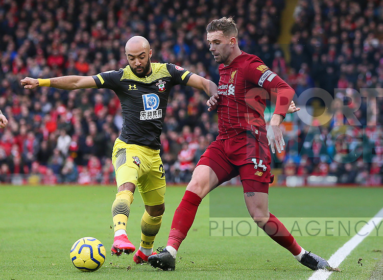Nathan Redmond of Southampton and Jordan Henderson of Liverpool battle for the ball during the Premier League match at Anfield, Liverpool. Picture date: 1st February 2020. Picture credit should read: James Wilson/Sportimage