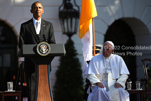 U.S. President Barack Obama (L) speaks during the arrival ceremony for Pope Francis (R) at the White House on September 23, 2015 in Washington, DC. The Pope begins his first trip to the United States at the White House followed by a visit to St. Matthew's Cathedral, and will then hold a Mass on the grounds of the Basilica of the National Shrine of the Immaculate Conception. <br /> Credit: Win McNamee / Pool via CNP