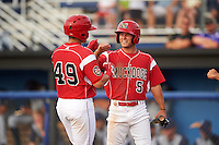 Batavia Muckdogs Aaron Knapp (5) congratulates J.J. Gould (49) after hitting a home run during a game against the Brooklyn Cyclones on July 6, 2016 at Dwyer Stadium in Batavia, New York.  Batavia defeated Brooklyn 15-2.  (Mike Janes/Four Seam Images)