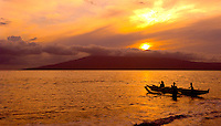 Outrigger canoe sails towards the sunset, Maui