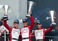 Mathias Beche (CHE), Thomas Laurent (FRA), Gustavo Menezes (USA) of REBELLION (CHE) on the podium during the 2018 Silverstone - FIA World Endurance Championship at Silverstone Circuit, Towcester, England on 19 August 2018. Photo by Vince  Mignott.