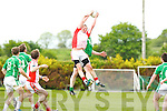 West Kerry's centre fielder Emmet Kennedy soars above Milltown's Mike Burke in Milltown on Sunday
