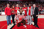 March 3, 2010: Wisconsin Badgers seniors Trevon Hughes (3), right of center, and Jason Bohannon (12), left of center, pose for a photo with their families and head coach Bo Ryan, far right, prior to a Big Ten Conference NCAA basketball game against the Iowa Hawkeyes at the Kohl Center on March 3, 2010 in Madison, Wisconsin. The Badgers won 67-40. (Photo by David Stluka)