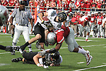 C.J. Mizell (#12), Washington State freshman linebacker, contorts the body of Oregon wide receiver Jeff Maehl with a big hit during the Cougars 43-23 loss to the Ducks Martin Stadium on the WSU campus on October 9, 2010.