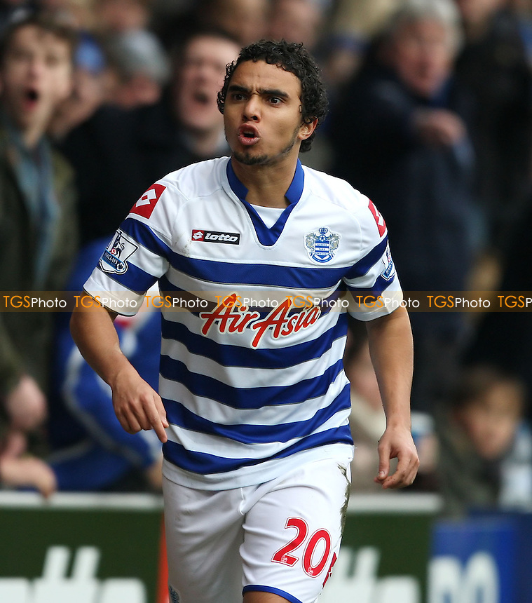 Fabio da Silva of QPR has a disagreement with the linesman - Queens Park Rangers vs Sunderland, Barclays Premier League at Loftus Road, London - 09/03/13 - MANDATORY CREDIT: Rob Newell/TGSPHOTO - Self billing applies where appropriate - 0845 094 6026 - contact@tgsphoto.co.uk - NO UNPAID USE.