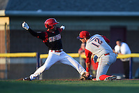 Williamsport Crosscutters first baseman Rhys Hoskins (12) tags out Iramis Olivencia (49) on a pick off during a game against the Batavia Muckdogs on August 25, 2014 at Dwyer Stadium in Batavia, New York.  Batavia defeated Williamsport 3-0.  (Mike Janes/Four Seam Images)