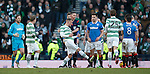 Ref Craig Thomson holds back an irate John Guidetti