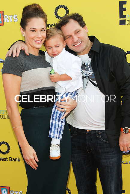 SANTA MONICA, CA, USA - NOVEMBER 16: Amanda Righetti, Knox Addison Alan, Jordan Alan arrives at the P.S. ARTS Express Yourself 2014 held at The Barker Hanger on November 16, 2014 in Santa Monica, California, United States. (Photo by Celebrity Monitor)