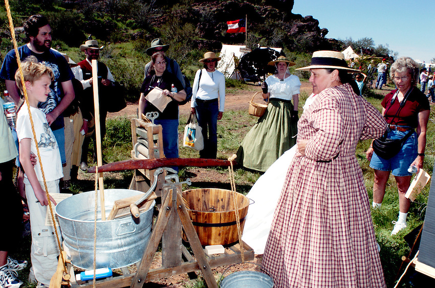 Ruth Ann Clark of Phoenix visits with the crowd Sunday at Picacho Peak about the life and dress of women during Civil War times. More than 3200 battle fans turned out Saturday and another 2650 invaded the Picacho Peak headquarters just to see the California Poppy which is popping up all over the park. On Sunday by midafternoon another 2500  had visited the park for flowers with a long line still showing and another 1500 showed up for the battles, almost 10,000 people for the entire weekend.