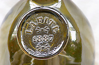 An antique wine bottle chateau lafite lafitte 1887, Pauillac, Bordeaux, France with a seal blazon