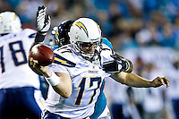 December 05, 2011:  San Diego Chargers quarterback Philip Rivers (17) is tackled from behind by Jacksonville Jaguars defensive tackle Terrance Knighton (96) during first half action between the Jacksonville Jaguars and the San Diego Chargers played at EverBank Field in Jacksonville, Florida.  ........