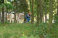 Boy on bicycle ridding through the city park. Rawa Mazowiecka Central Poland
