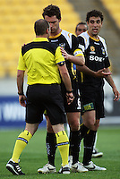 Phoenix captain Tim Brown reassures referee Craig Zetter after a foul on the irate Daniel during the A-League match between Wellington Phoenix and Newcastle Jets at Westpac Stadium, Wellington, New Zealand on Sunday, 4 January 2009. Photo: Dave Lintott / lintottphoto.co.nz