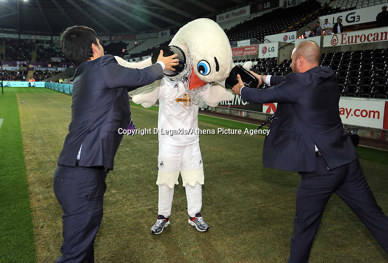 Pictured: Swansea City mascots Cyril and Cybil take part in the ice bucket challenged, getting drenched by Baz St Clair and Juan Salguero. Tuesday 26 August 2014<br />