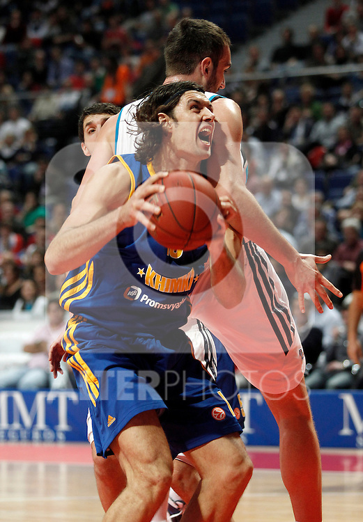 Real Madrid's Mirza Begic (r) and BC Khimki MR's Kresimir Loncar during Euroleague 2012/2013 match.November 23,2012. (ALTERPHOTOS/Acero)