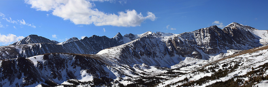 The high peaks of the Indian Peaks Wilderness area stretch across the horizon.