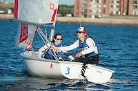 Sean Beaulieu,'18,  right, Captain, and Jen Ryan,'19, crew, work together as they practice with other members of the Salve Regina Sailing Team in the Newport Harbor.