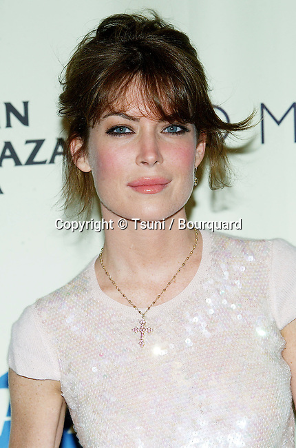 Lara Flynn Boyle arriving at the 11th Annual Race to Erase MS at the Century Plaza in Los Angeles. May 14, 2004.