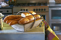 French bread baguette in a basket. Chateau Lapeyronie, Cotes de Castillon, Bordeaux, France