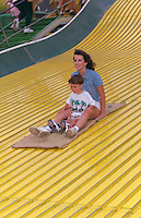 Mother and son riding giant slide at Minnesota State Fair age 30 and 4.  St Paul  Minnesota USA