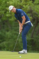 HaoTong Li (CHN) sinks his putt on 1 during day 1 of the Valero Texas Open, at the TPC San Antonio Oaks Course, San Antonio, Texas, USA. 4/4/2019.<br /> Picture: Golffile | Ken Murray<br /> <br /> <br /> All photo usage must carry mandatory copyright credit (© Golffile | Ken Murray)