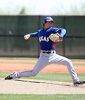 Cody Buckel #63 of the Texas Rangers pitches in an extended spring training game against the San Diego Padres at the Rangers minor league complex on April 16, 2011  in Surprise, Arizona. .Photo by:  Bill Mitchell/Four Seam Images.