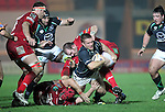 Ethienne Reynecke runs into trouble..RaboDirect Pro12.Scarlets v Connacht.02.03.12.©STEVE POPE