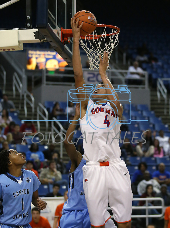 Bishop Gorman's Chase Jeter shoots against Canyon Springs during the Division I championship game in the NIAA basketball state tournament at Lawlor Events Center, in Reno, Nev., on Friday, Feb. 28, 2014. Gorman won the title 71-58. (Cathleen Allison/Las Vegas Review-Journal)