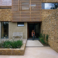 One of the daughters approaching the front door of the contemporary property