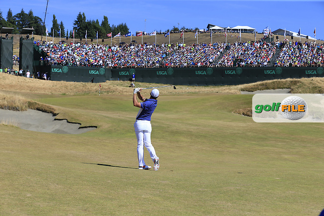 Rory MCILROY (NIR) chips onto the 18th green during Sunday's Final Round of the 2015 U.S. Open 115th National Championship held at Chambers Bay, Seattle, Washington, USA. 6/21/2015.<br /> Picture: Golffile | Eoin Clarke<br /> <br /> <br /> <br /> <br /> All photo usage must carry mandatory copyright credit (&copy; Golffile | Eoin Clarke)