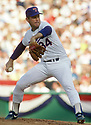 CIRCA 1989:  Nolan Ryan #34, of the Texas Rangers, pitching during a game from his 1989 season with the Texas Rangers. Nolan Ryan played for 27 years with with 4 different teams, was an 8-time All-Star and was inducted to the Baseball Hall of Fame in 1999.(Photo by: 1989 SportPics 2018)  *** Local Caption *** Nolan Ryan