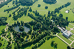 Aerial view of Althorp House and the oval lake and island where Princess Diana of Wales is buried. Great Brington, Northamptonshire England 2007.