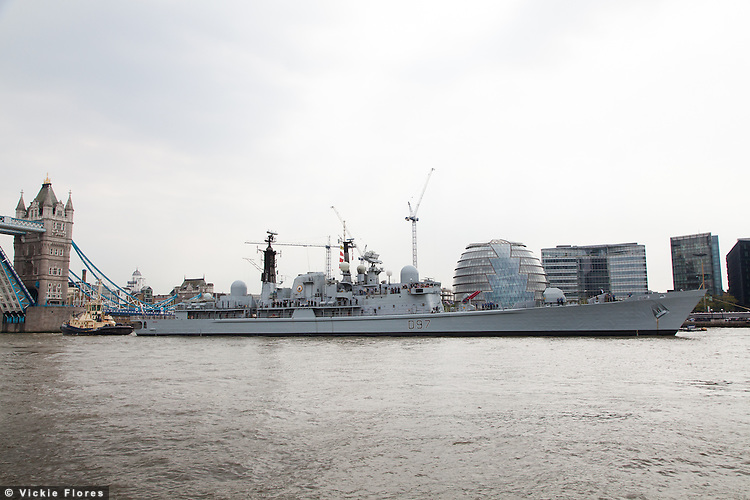 HMS Edinburgh arrives in London under Tower Bridge and passes City Hall on 7 May 2013 for the start of her farewell tour of Great Britain. HMS Edinburgh is a Type 42 (Batch 3) destroyer of the Royal Navy was decommissioned on 6 June 2013.
