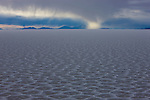Bolivia, Altiplano, rain storm on Salar de Uyuni, world's largest salt pan