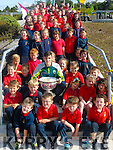 Kerry Minor Graham O'Sullivan pictured with the children of Cillín Liath NS on Monday.