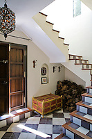 The open staircase creates an airy feel in the entrance hall