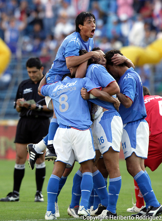 Cruz Azul forward Francisco Kikin Fonseca is congratulated by his teammates and Cesar Delgado (top) after scoring the first goal against Toluca Red Devils at the Blue Stadium, February 4, 2006. Cruz Azul won 2-1. © Photo by Heriberto Rodriguez